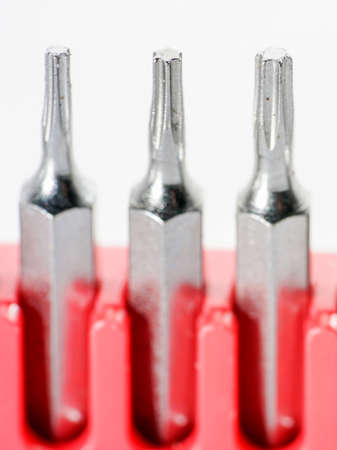 Screwdriver bits made from tool steel in the red box photographed against a white background in the studio