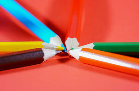 Colorful crayons, pencils with plain paper as a background with structure