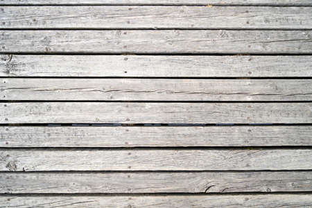 Natural wood with a rough structure, photographed outdoors in daylight