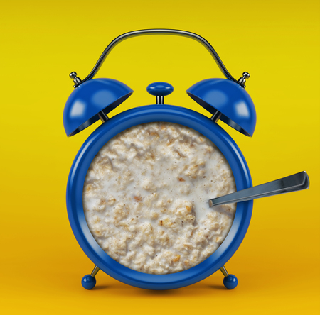 Blue alarm clock with porridge concept isolated on yellow background