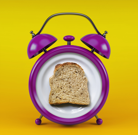 Pink alarm clock with toast bread concept isolated on yellow background