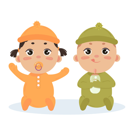 Newborn baby boy and girl with nipple twins in long sleeved footies and scratch mittens. Sitting with milk bottle. Cute little children in orange and green isolated on white background