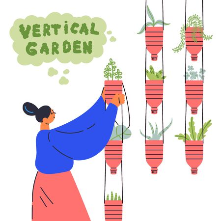 Decorative vertical garden concept.Woman grows plants in plastic bottles upcycled into pots.Vertical garden text.Environment friendly eco design.A new way to decorate the interior with house greenery