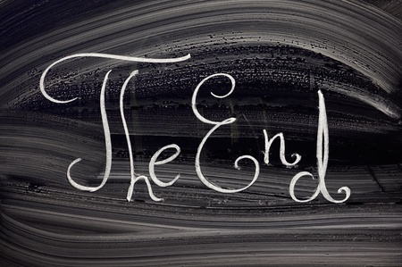 the end: The end. Writings on classical blackboard. Stock Photo