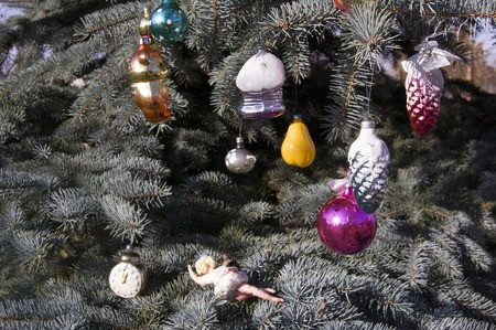 old toys: Old toys on the Christmas tree .Christmas toys on blue spruce