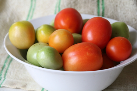 fresh red, yellow and green delicious tomatoes