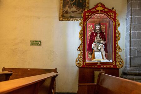 MEXICO CITY - JULY 20, 2018: Jesus figure in a showcase and a sign: Escape route