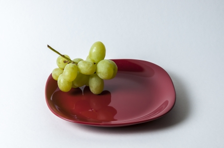 red plate with grape set-up photo