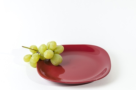 red plate with grape set-up Stock Photo - 16829317