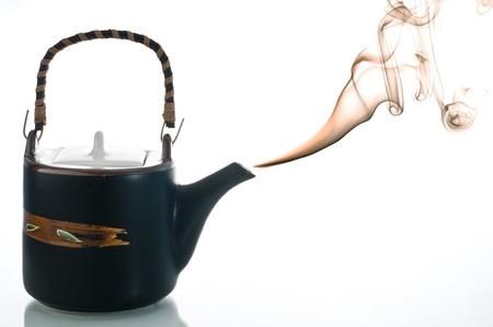 Smoking teapot with coloered smoke on white background Stock Photo - 17200779
