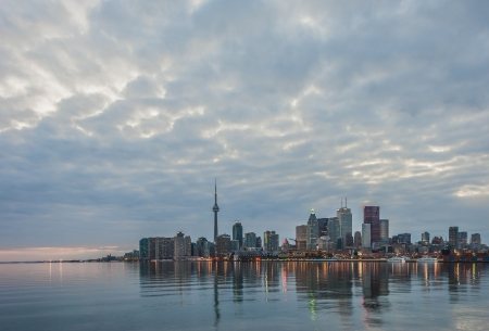 Toronto skyline at sunset with water reflection photo