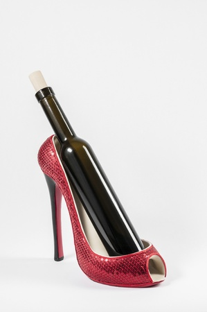 Red high heel wine rack in white background