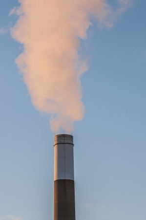 smoking chimnney stack in blue sky Stock Photo - 18206358