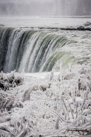 niagara falls on a snowy landscape on winter time photo