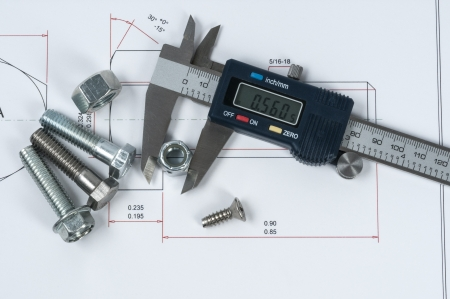 Vernier caliper and assorted screw, nuts and bolts photo