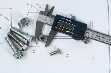 vernier caliper: Vernier caliper and assorted screw, nuts and bolts