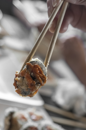deep fried japanese sushi with sauce photo