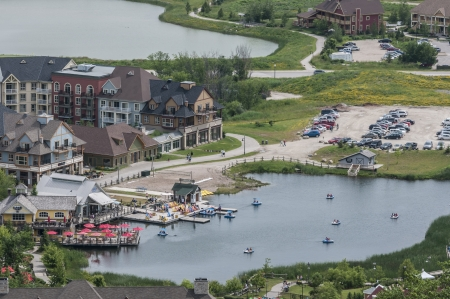 Lake and paddle boat aerial photo