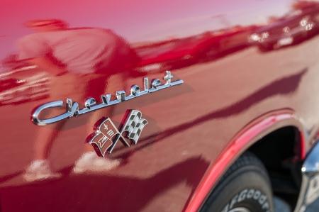 superleggera: Chevrolet logo embossed on red corvette