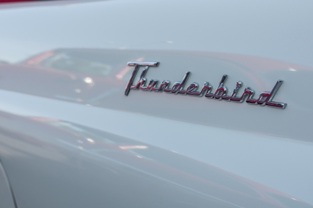 Thunder bird logo embossed on a white classic car Editorial