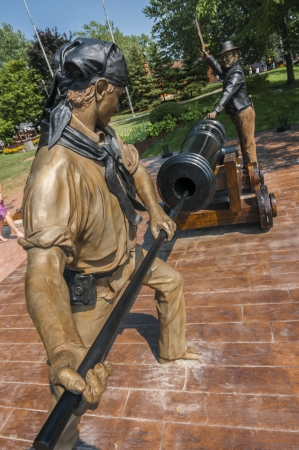 Sculpture of people loading ammunition for cannon photo