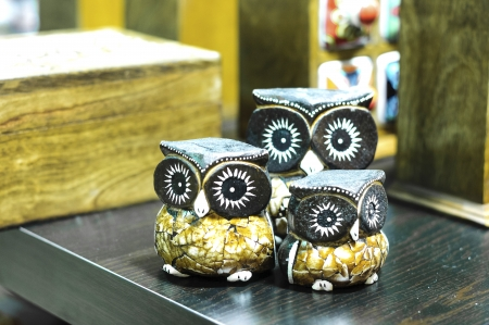 three pieces wooden owl  table top display Stock Photo
