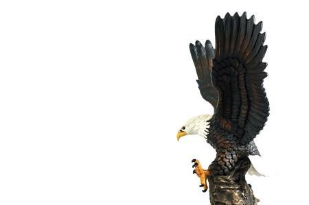 Eagle sculpture isolated on a white background photo