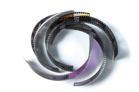 assorted curled film strip on white