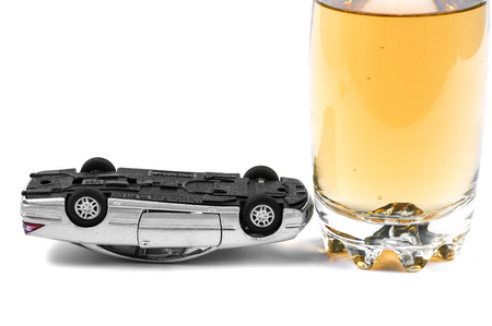 Glass of alcohol and upside down car