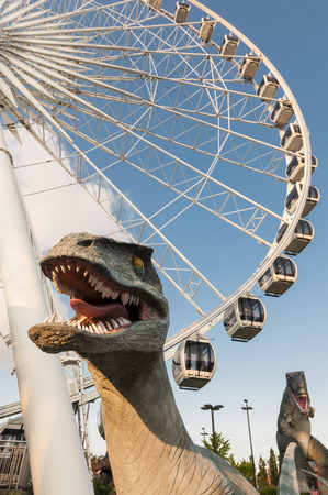 Amusement park with dinosaur and ferris wheel