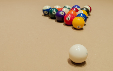 A white cue ball and the set of billiard pool game Stock Photo