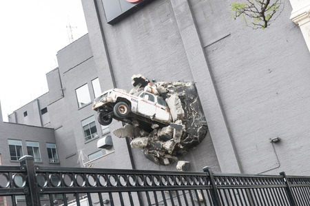 A decorative car crashed into the building 스톡 콘텐츠
