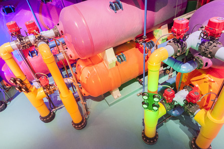 A colorfull water pipes gauges and water tanks photo