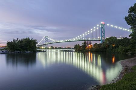 ambassador: Ambassador bridge linking Windsor canada and Detroit usa at dusk