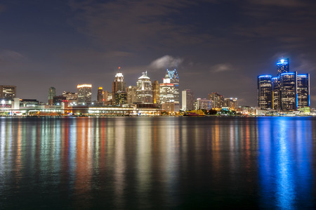 The skyline of Detroit michigan at night time photo