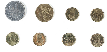 A collection of macau coins on white background photo