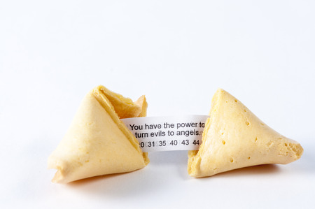 Cracked open fortune cookie revealing the luck inside photo