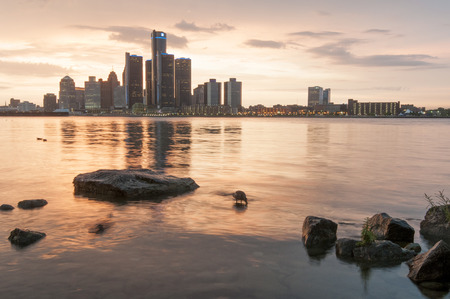 sunset over the skyline of detroit usa photo