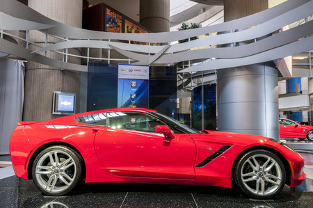 A red corvette sting ray car on display