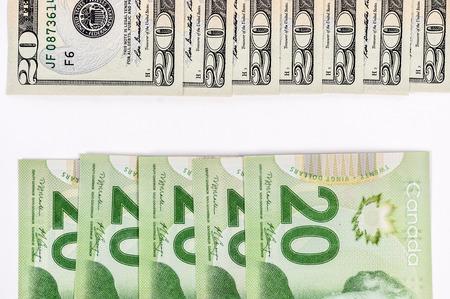 Pile of 20 dollar bills in white background photo