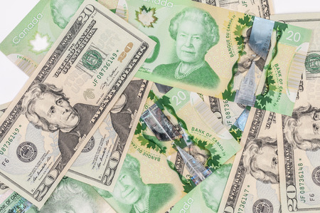 Mixture of canadian and US dollar bills photo