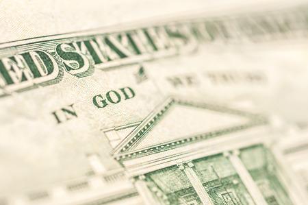Word GOD incription on a US dollar bill photo