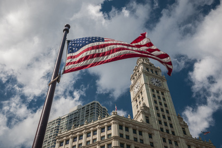 Waving USA flag with building on back ground