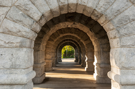 stone arches: A series of stone arches with sun shining through