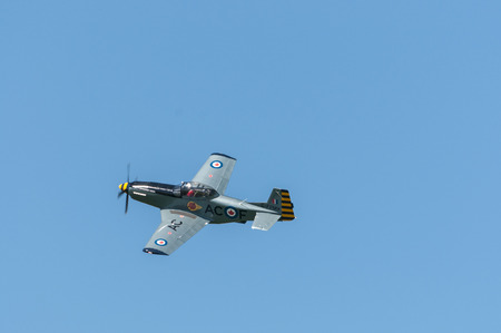 titan: T-51 Titan  soaring under clear blue sky Editorial