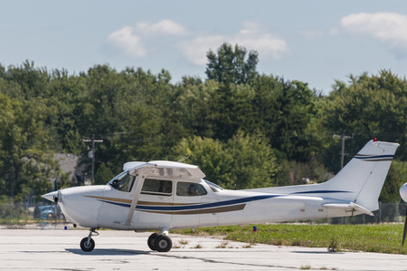 cessna: A single plane engine park in the tarmac Stock Photo
