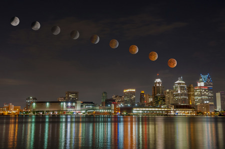 penumbra: The Lunar eclipse of October 08 2014 at 5 in the morning over detroit city skyline