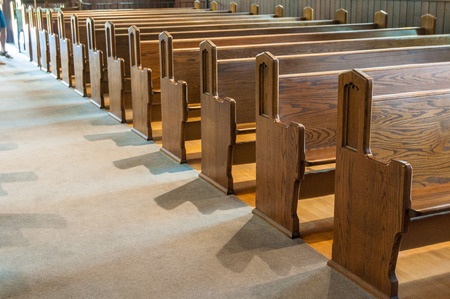A row of antique  wooden church pews.