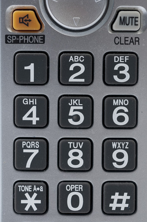 dial pad: A digital phone dial pad in black and grey