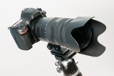 DSLR camera mounter on tripod with long telephoto lens